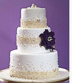 Elegant pearl wedding cake with a big dark purple flower by SinnersFood, via Flickr