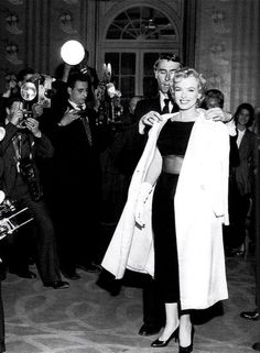 """Marilyn Monroe at a press conference in England for the movie """"The Prince and The Showgirl"""", 1956."""
