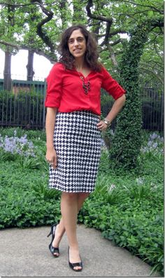 Red blouse, black and white houndstooth skirt