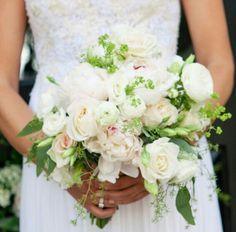 Bridal bouquet of peonies, rananculus, garden roses, lisianthus, and achemilla.   In bloom, ltd.