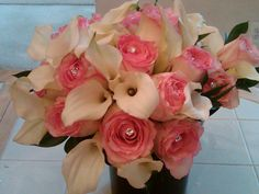 White calla lilies with pink roses and a little bling #MyWeddingFlowers, #Bouquets www.myweddingflowers.us