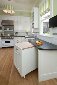 """TIP: KITCHEN DETAIL """"Use a pullout cabinet. This pullout cabinet works great in small kitchens as a dual-purpose storage and chopping block that can be moved to the center of the kitchen and put away when not in use to save space."""" JKA"""