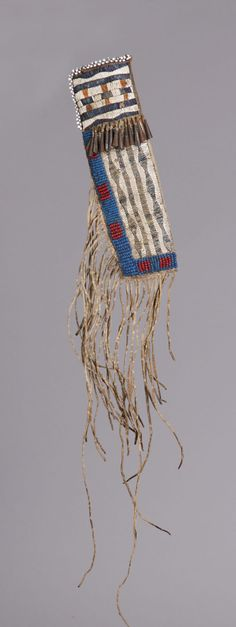 Pre 1850. Blue & red pony beads, tin cones, quill work. Original native, tanned hide, harness leather insert. - See more at: http://www.cottoneauctions.com/lots/3459/dakota-knife-sheath#sthash.9TyZWtqG.dpuf