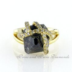 The centre stone is a 13.62ct brown rough diamond with 42 = 0.30ct WH/VS – SI round brliliant cut diamonds micro set in the setting of an 18k yellow gold ring