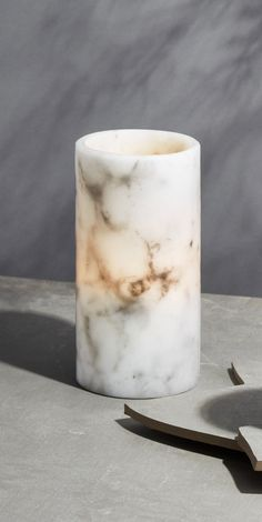 This set of contemporary candles will add a modern touch and a warm glow to just about any space. Features a set of two large pillars, each with a natural flicker and a marble-patterned, life-like wax exterior. These candles are flameless - en Marble Pillar, Pillar Candles, Contemporary Candles, Modern Rustic Decor, Marble Pattern, Moroccan Decor, Candle Set, Home Decor Accessories, Cheap Home Decor