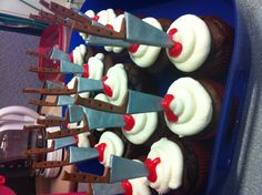Butcher knife cupcakes. Knives are made of fondant and spray painted with edible silver paint. They were a hot commodity. I didn't even get one!