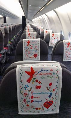 TAP Airlines - Lenços dos Namorados - February 2016 Sweetheart Handkerchiefs: They were used as a ritual of romantic conquest. The girl's sweetheart should use the handkerchief in public so that everyone would know he had started a love relationship with her. Since most girls did not finish school during this period in history, most of these handkerchiefs have spelling errors which only adds to their charm! Photo: Aliança Artesanal Namorados