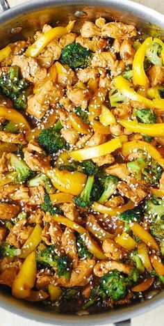 Chicken, broccoli, and yellow bell pepper stir-fried in Asian sauce