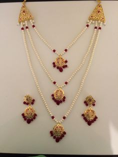 Three layer long bridal neckalce set with earrings in rubies Gold Jewelry Simple, Gold Rings Jewelry, Ruby Jewelry, Stylish Jewelry, Antique Jewellery Designs, Gold Jewellery Design, Diy Jewelry Necklace, Earrings, Gold Necklace