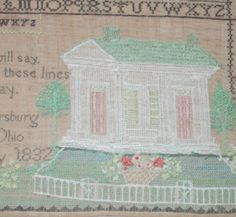 An up-close image of a sampler from 1832. This sampler featured some details that were finely executed. Here it is seen after conservation treatment.