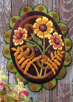 Painted Daisies - Wool Applique Penny Rug design by Wooly Lady. Kit by winterberrycabin.com