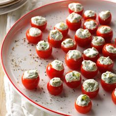Cucumber-Stuffed Cherry Tomatoes Recipe -This is a wonderful appetizer that you can make ahead. I often triple the recipe because they disappear fast. —Christi Martin, Elko, Nevada