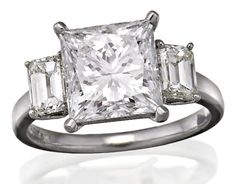 DIAMOND RING The square modified brilliant cut diamond weighing 4.02 carats is claw set between a pair of emerald cut diamonds together weighing approximately 0.80 carats, mounted in platinum, size M. Accompanied by a GIA report numbered 17197898, dated 5 May 2008, stating that the 4.02 carat diamond is D colour and VS2 clarity.