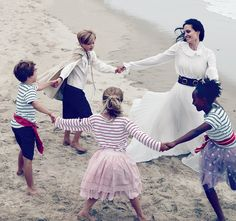 """Circle Dance - Jolie Pitt with her four younger children. """"These are their most important years,"""" she says. The actress wears an Oscar de la Renta dress and a Zana Bayne belt."""