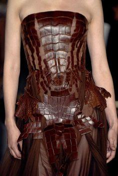 Brown leather creature. Jean Paul Gaultier Fall 2006 #runway #style #JeanPaulGaultier