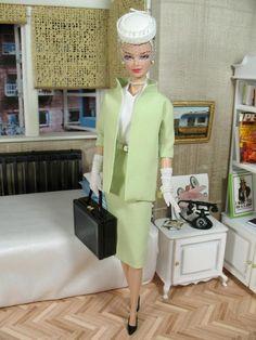 miniature version of Hitchcock's 'Rear Window' set ft. Grace Kelly barbie in celadon suit