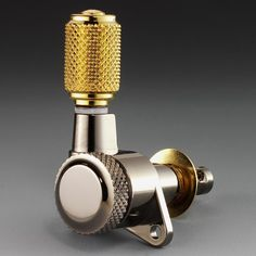 Klemmmechanik M6 2000 Ruthenium /Gold | This is a guitar tuner/machine head in case you were wondering! Check out or latest Guitar Tuners Deals & Reviews: guitarjunkie.com