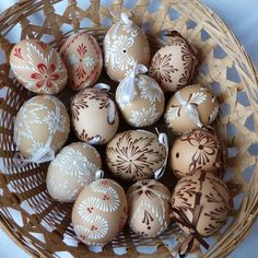 Easter eggs painted with melted wax crayons. (Blogger says she uses a pin stuck in a pencil to draw with liquified crayon. She melts them over a candle in an oil burner.)