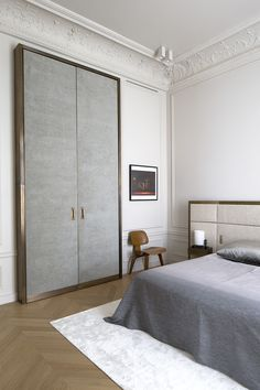 Private appartment in Paris, bedroom and giant brass door, interior design by Rodolphe Parente