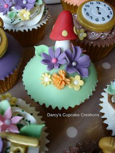 Mushrooms and flowers by Darcy's Cupcake Creations, via Flickr...from the Alice in Wonderland series