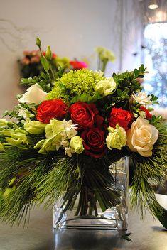 mini green hydrangea, paperwhites, roses, lisianthus, boxwood, white pine, dendro orchids