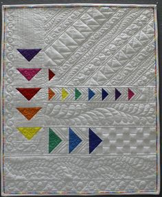 Rainbow flying geese quilt by Brenda Roach.  Photo by The Quilt Journal.