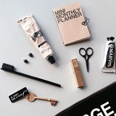 Daily essentials from @amming_j including #marvis Amarelli Licorice toothpaste and toothbrush Yves Saint Laurent lipstick and Aesop hand cream #flatlay #essentials #offenstore