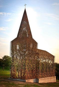 A see-through church in Limburg, Belgium by Pieterjan Gijs and Arnout Van Vaerenbergh, constructed from 100 stacked layers of weathered steel plate.