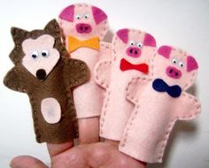 The Three Little Pigs felt finger puppets. Very cute.