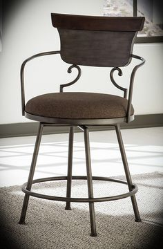 Upholstered Counter Height Chair Moriann Two Tone Width: 21'' Height: 40.25'' Depth: 24.25'' With its unique take on vintage meets modern, this counter height swivel barstool is certainly turning heads. The incorporation of metal feels so contemporary, while the rich use of distressing makes it flow beautifully with your vintage-inspired pieces.