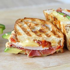 Prosciutto-Wrapped Turkey, Avocado & Swiss Panini - perfect way to use up left over Thanksgiving turkey