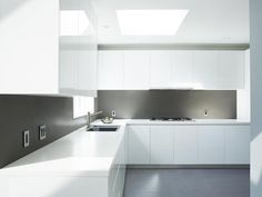 High Gloss White Kitchen With Corian Counter Top And Back Splash Design By Mazzie