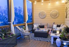twinkle lights on deck above outdoor living space with sectional