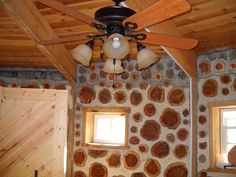 cordwood interior wall in progress of being white-washed