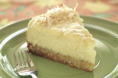 """Pina Colada Cheesecake -   Cheesecakes are great """"entertaining"""" desserts because they must be prepared in advance and they feed a crowd."""