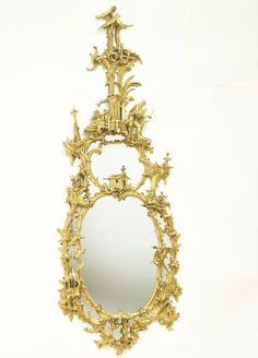 Mirror    Place of origin:  London, England (probably, made)    Date:  1750-1760 (made)    Artist/Maker:  Johnson, Thomas, born 1714 - died 1782 (after, designer)    Materials and Techniques:  Carved and gilded wood