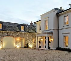 We like the idea of doing the garages in stone for a contrast between stone and white house exterior finish. We also really like the gravel driveway.