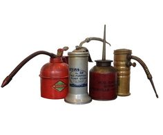 Vintage Oil Cans. Hubby would love these..  http://vandm.com/Set-of-Four-Vintage-Oil-Cans/3_239_60=0_new=1_product=395480.aspx