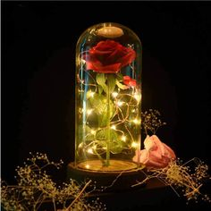 Add a little touch of magic and a feel of enchantment with this beautiful Beauty and the Beast inspired Night Light. The Beauty and the Beast Night Light is a perfect addition to your room or your kid's bedroom and an ideal gift for your loved ones. - The Beauty and the Beast Rose Night Light comes with a LED light in a glass dome, on a wooden base. A beautiful and unique decor to your home. - The enchanted rose is made of high-quality silk that looks like the real thing - they are soft and…