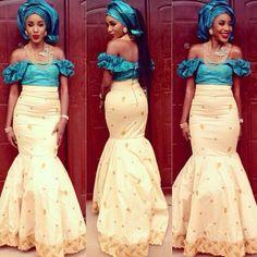 Aso-ebi style cream and teal Nigerian weddings bride