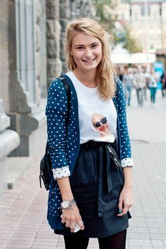 kyiv streetstyle. blue dotted cardigan on graphic tee tucked into navy high waist skirt.