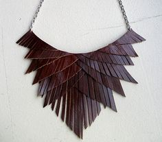 http://theyroaredvintage.com/wp-content/uploads/2012/09/Fringe-Bib-Leather-Necklace.jpg