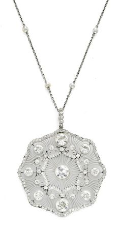 An Edwardian Diamond and Seed Pearl Pendant, circa 1910.