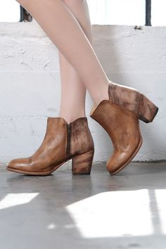 Transitional booties to go with any outfit, hot or cold. YELL in Tan