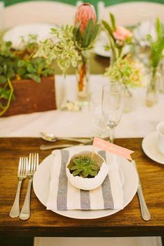 Can't find cloth napkins that fit in with your reception decorating choices? Use Elly dish towels.