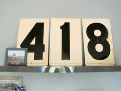 Old Gasoline Numbers used in Motocross Baby's room ~ they're daddy's riding number!