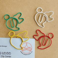 Minnie Mouse shaped paper clips - kinda look like bees to me.