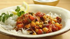 Eat meatless with a simple and delicious dish of beans, fire roasted tomatoes and curry that can be on your dinner table in 30 minutes.