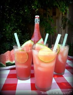 Sparkling Watermelon Lemonade     (1 (6-pound) seedless watermelon, cut into 1-inch chunks (8 cups)  1 can(s) (12 ounces) frozen lemonade concentrate  1 can(s) (12 ounces) pink lemonade concentrate  Chilled seltzer water  Lime slices, for garnish)