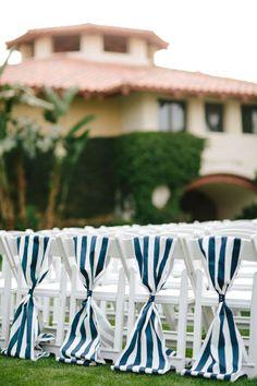 Nautical themed wedding ceremony chair decor